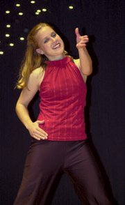 Katie Beck reveals her enjoyment of the De Soto High School Diamonds final 2006-2007 performance Saturday at its spring performance in the auditorium at Lexington Trails Middle School.