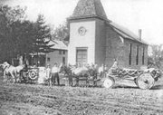 Decorated wagons line up for a parade in De Soto in this photo with no date and no explanation. The Methodist Episcopal Church in the background stood just to the south of Abbott Hall on Peoria Street, which at that time did not even have gravel.