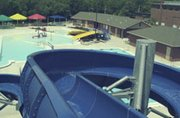 The 25-foot high water slide at the De Soto Aquatic Center has been joined by the yellow tot and family slides in the pool's second year. The pool opens at 1 p.m. Saturday.