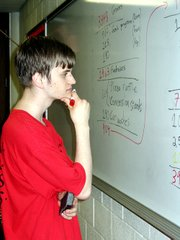 Hal Laurence, a Lansing High School junior, surveys fundraising efforts recorded on a white board at the school. Laurence and other Future Business Leader of America students are raising money for a trip to the FBLA nationals in Chicago.