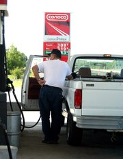 Terry Rush, Lansing, fills his pickup truck at a cost of $3.09 per gallon. Despite gasoline prices in excess of $3 a gallon, many drivers say they aren't changing their habits.