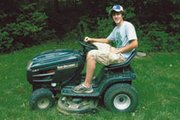 Brian Murdock, 16, mows lawns to earn some extra money in the summer. He uses a riding lawnmower because the yards in his neighborhood are large.