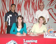 Erin Rogers, a 2007 Lansing High senior, signs her letter-of-intent to pole vault at Baker University at her signing ceremony. Pictured at the ceremony are, from left, front row: Erin Rogers and Lisa Rogers; and standing: Baker pole vaulting coach Mackie Valentin and LHS track coach Errol Logue.