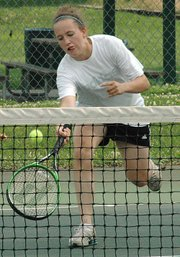 Katelyn Griffen charges the net for a shot during a recent Junior Team Tennis tournament.