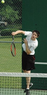 Daniel Miskowic, a member of the Leavenworth County Junior Team Tennis squad, fires a serve during a recent match at David Brewer Park in Leavenworth. Miskowic is one of 23 local players participating in the inaugural season of Junior Team Tennis in the county.
