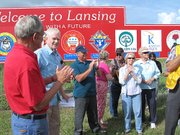 "Mayor Kenneth Bernard, left, and Gene Young, give short speeches during a dedication ceremony Wednesday. Representatives from 11 Lansing service clubs came out to show support of the new ""Welcome to Lansing"" sign along Kansas Highway 7."