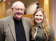 Gwyndolyn Jones, right, the 2005 Lansing High School valedictorian, is finding success in organic chemistry at the University of Kansas. Jones, who is in the KU Honors Program, is pictured here with KU Chancellor Robert Hemenway.