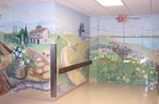 Cathy Kline, who has a gallery in Parkville, Mo., painted this mural at the Senior Behavioral Health Center at St. John Hospital. She said her mother's death from Alzheimer's disease helped inspire the work.