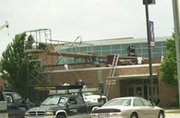 A crew works to install a new roof Monday on Lexington Trails Middle School. The school also is getting new cooling and heating units installed on the roof that will make to control temperatures in classrooms. It is the big capital outlay project in USD 232 this summer, although numerous projects are underway to get schools reading for August.