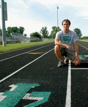 De Soto's Peter Harley knew little about pole vault when he took over three years ago but has been quick to get involved.