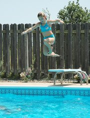 Kelsey Everett swims in her grandmother's pool Tuesday afternoon as a way to get some relief from the heat. Meteorologists have issued an excessive heat warning for several counties including Leavenworth. The upper 90-degree temperatures are expected to continue through Tuesday.