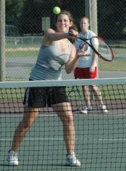 Ashley Harrington, Lansing High sophomore, works on a net drill during tennis practice Tuesday morning.