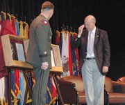 Lt. Gen. William Caldwell IV, left, and U.S. Senator Pat Roberts, R-Kan., unveil the shadow boxes for Capts. Meriwether Lewis and William Clark for the Hall of Fame at the Command and General Staff College. Their induction ceremony  coincided with the dedication of the new Lewis and Clark Center that will house the command college.