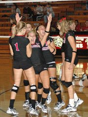 The Lansing High volleyball team celebrates after winning the Lansing Invitational for the first time since 2003.