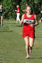 Lauren Jaqua digs in near the end of the varsity girls race on Wednesday at the Bonner Springs Invitational. Jaqua placed third.