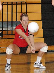 Lansing High senior Katie Nietzke returns a serve during Lansing's victory over Olathe North.