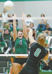 De Soto junior Danielle Price leaps for a block Thursday as the volleyball team played Jefferson County North.