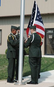 Leavenworth High School Junior ROTC students raise the flag at the dedication ceremony Monday at the Leavenworth County School of New Beginnings.