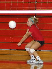 Lansing High sophomore Rachel Milnark digs the ball during Lansing's victory over Santa Fe Trail.