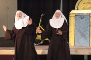 "Linda Finch, left, and Trish Gleisberg rehearse a number for the upcoming performance of ""Nunsense,"" which will benefit the building fund at St. Francis de Sales Catholic Church. The play opens this Friday at 8 p.m. at Immaculata High School and runs this weekend and next."
