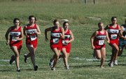 The Lansing High JV girls take off from the starting line at the start of their race Thursday at the KVL championships.