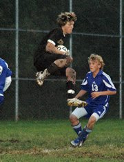 Lansing High goalkeeper Ethan Alexander soars for a save during Lansing's 4-0 victory over Perry-Lecompton.