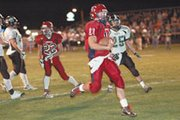 Eudora senior Travis Clarke bursts into the endzone Friday for