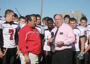 Dave Grond of HyVee Grocery Stores presents the KCTV5 HyVee High School Football Team of the Week award to Lansing High football coach Bill Pekarek and his team on Thursday afternoon. Lansing takes a 7-1 record into its 7 p.m. Friday home game against KC-Schlagle.