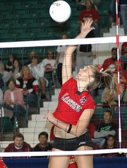 Julia Bates goes up for a spike during Lansing's victory over Emporia on day one of the Class 5A state tournament.