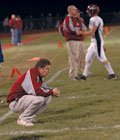 Eudora senior quarterback Brynnen Webb walks off the field while his father, coach Gregg Webb, mulls over the team's 13-8 upset loss to Basehor-Linwood in the first round of the Class 4A playoffs. Eudora finished the season 8-2.