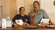 Annette and Chris Cook stand at the counter of Amore Chocolate