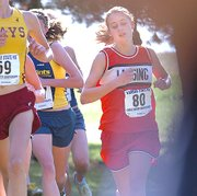 Lansing High sophomore Lauren Jaqua competes at the Class 5A state cross country meet. Jaqua placed 16th overall.