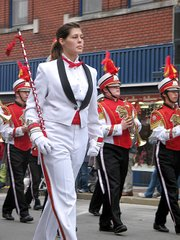 Megan Wood, a senior drum major, leads members of the Lansing High School Marching Band during Monday's Leavenworth County Veterans Day Parade.