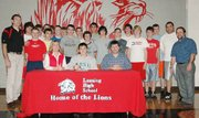 Seated between his parents and surrounded by his teammates and coaches, Lansing High senior Nick Flynn signed his national letter-of-intent on Tuesday, Nov. 20, to wrestle at NCAA Division I South Dakota State University.