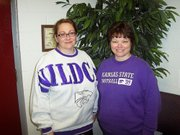 Jan Jorgensen, right, principal of Lansing Intermediate School, dressed up with Mary Alice Schroeger, director of the Lansing Educational Foundation Fund, in K-State, their rival college, apparel. The two donned Wildcat gear for a day to reward LIS students for earning the most money in the Pennies for Playground fundraiser.