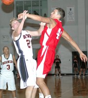 Lansing High senior Stephen Didde blocks a shot by Bonner Springs junior Chance Crawford on Friday night.