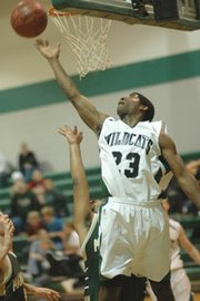 De Soto senior Andre Linzy cut down the baseline to drop in a shot Tuesday against Maranatha. He led the team with 17 points.