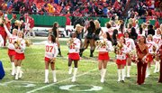 Jasmine Hill, fourth from left in front row, dances during the halftime show at the Chiefs vs. Chargers game Sunday at Arrowhead Stadium. Hill, a sixth-grader at Lansing Middle School, is in her second year as a Junior Chiefs Cheerleader.