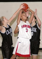 Lansing Middle School seventh-grader Morgan Johnson puts up a shot during the Lansing Invitational championship game.
