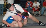 Lansing High freshman Zach Hammer tries to keep the upper hand during his match with Santa Fe Trail's Skylar Donley.