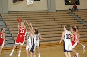 Chrissie Jeannin avoids three Eudora defenders for a layup in Friday at Paola High School.