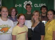 Top club officer awards were given to, front row, from left, reporter Jenny Whipple, Bonner Springs; historian Karisa Garber, Leavenworth; secretary Beth Scharinger, Leavenworth; and treasurer Shilyn Guthrie, Tonganoxie. Back row, from left, Eleanor Heimbaugh of Basehor and Jacob Reynolds, Tonganoxie, were honored with the American Youth Foundation National Leadership Award. Tonganoxie's James Bailey received the Prudential Spirit of Community Award for being named the top high school volunteer of the year.