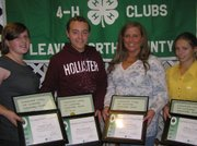 Four 4-H teen members received the 4-H Key Award this year.  The award is reserved for approximately the top 1 percent of the total 4-H membership in Kansas. Pictured, from left, are Sarah Smith of Tonganoxie, Max Packard and Rachel Berry of Leavenworth and Shilyn Guthrie of Tonganoxie. These youth, in addition to Audrey Knapp of Basehor (absent from photo), also received a Leavenworth County 4-H Leadership Scholarship sponsored by the County 4-H Council.