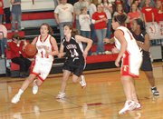Tonganoxie High senior guard/forward Liz Baska drives to the basket Thursday night against Lansing. Baska had 24 points and 16 rebounds in Tonganoxie's 52-42 home-opening victory.