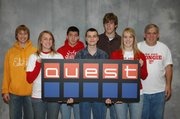 Members of the Tonganoxie High School Quest academic team that competed Dec. 1 at Washburn University in Topeka are, from left, Christopher Jordan, Alicia Osborne, Robert Brotherton, Donald Dyster Jr., Austin Smith, Kristen Titterington and coach Ron Lewis. THS is one of 16 finalists for the ongoing competition, which will be televised on KTWU beginning in February. THS also won first place among Class 4A schools.