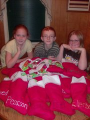 Haleigh Peel, 11, left, J.D. Peel, 12, and Torrie Evans, 14, pepared 23 stockings for their father, Joe Peel, and his platoon in Iraq. The Peel family sent the stockings out earlier in the month.