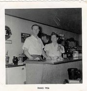 Jim and Elaine McGee are pictured behind the counter at the Green Haven Cafe, which used to be at the corner of Main and Mary streets. The two, photographed at Christmas 1956, operated the cafe from 1955 until 1972.