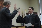Leavenworth County District Judge David King swears in new county commissioner J.C. Tellefson. Tellefson represents the 1st District, which is in the norther part of the county. On Jan. 8, he was sworn into office - and elected to chair the commission.