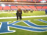 Claudia Alterman, left, and Kyrstan Perry had field access to Thursday's Orange Bowl as KU football equipment managers.