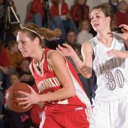 Tonganoxie senior Shannon Carlin (left) makes a break with the ball Friday on the way to defeat Mill Valley girls 65-33.